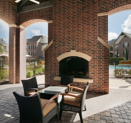Outdoor Fireplace at Camden Cypress Creek Apartments in Houston Texas