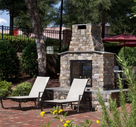 Outdoor Fireplace at Camden Lake Pine Apartments in Apex, North Carolina
